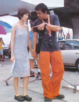 Amy Kwok and Lau Ching-wan on the film set